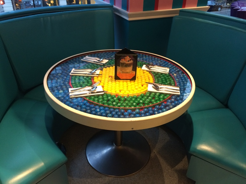 Tables in the cafe are filled with gumballs.