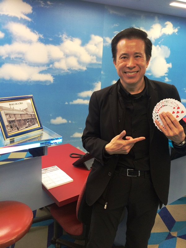 Rod Chow entertains visitors with amazing card tricks.