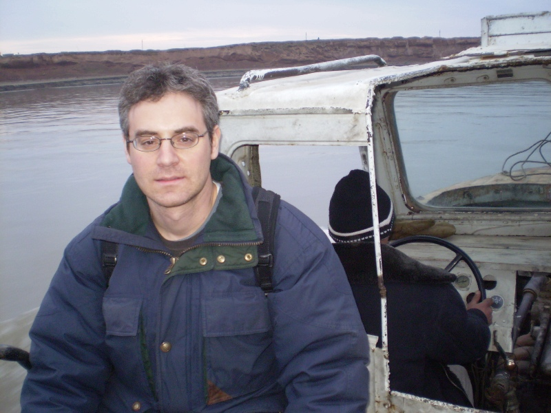 Larry Schwarz on the boat over the Panj River from Tajikistan to Afghanistan