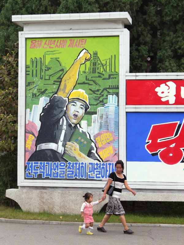 A textile factory propaganda mural in Pyongyang, North Korea